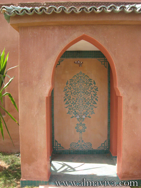 Almaviva Zellige - Moroccan shower. The green glaze (see keywords) is scratched off to draw the tree, then the tiles are covered with a thin transparent glaze