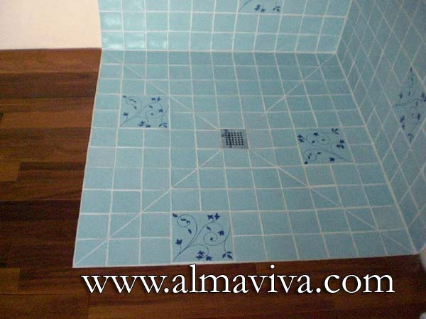 Almaviva Handmade tile - Ref. CD23 - Celadon bathroom (see Keywords). 10x10 cm (about 4''x4'') plain tiles in the shower, alternating with a 20x20 cm (about 8''x8'') decorated tile